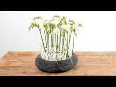 Black and White Freesia design ~ Nelleke Bontje - freesia Ambiance, raffia, white grid, white rotan, black wire, tillandsia, oasis,  | Flower Factor