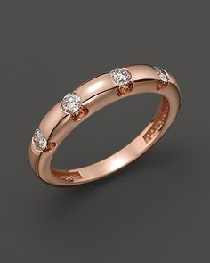 Diamond Ring Set In 14K Rose Gold, 0.30 ct.  Reg INR 139,818.00  Sale INR 69,909.00  Sale ends 1/1/12  Diamonds dot a 14K rose gold band.        Diamond: 0.30 ct. t.w. Color/Clarity: I1/HI      14K rose gold. Imported      Ring Size Chart      All gemstone carat weights (ct. t.w.) are approximate; variance may be .05 carat      Web ID: 527264