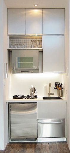 Kitchen:Tiny Kitchen Ideas Super Small Kitchen Concept White Clean Cabinets Polished Stainless Steel Oven Polished Microwave Black Fused Double Cook Tops Polished Stainless Dishwasher Ideas Very Clever Compact Kitchen for Small Apartments Tiny Spaces, Small Apartments, Studio Apartments, Espace Design, Deco Studio, Studio Apt, Mini Kitchen, Kitchen Small, Kitchen White