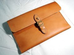 Leathinity - Hand Stitched Brown Leather Case for 11'' MacBook Air. $94.99, via Etsy.