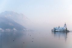 Castle Ort in Gmunden, Austria at the lake Traunsee with mountain Traunstein by Roob | Stocksy United