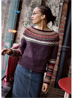 The beautiful combination of rich autumn hues in this patterned yoke is the result of many experiments with different yarns, gauges, and colors. Michele Rose Orne designed a classic round-yoke pullover with updated styling. She omitted the traditional
