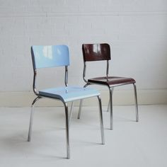 A pair of Bakelite dining chairs designed by Rene Herbst, France 1940's.  One burgundy and one sky blue, these dining chairs have Bakelite seat and back rest on a tubular chromed-steel frame.  A very sweet pair that will add colour to your kitchen.  Very solid chairs with some pitting to the frame as you'd expect with things of this age.  Price is for the pair.