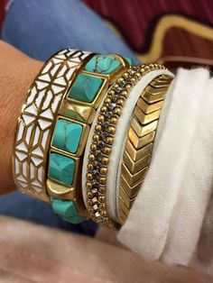 green with gold bracelets http://www.justtrendygirls.com/modern-and-stylish-bangles/