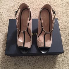 Sergio Rossi heels. EUC Black leather/khaki suede. Buckle strap. Only worn once. Faint black smudge on inner heel, but if professionally cleaned would likely resolve the issue. I'm a 7.5, but lean more towards a 7 if only in whole sizes. Will fit a size 8. Sergio Rossi Shoes Heels