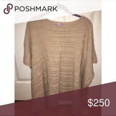 Cashmere poncho sweater: Calypso St. Barth Beautiful cashmere poncho. In perfect condition, you'd think it's brand new. This luxe cashmere sweater effortlessly layers over basic tees with a chic oversized fit. Textured rib trim and asymmetric hem add a sophisticated cool to a timeless classic. Calypso St. Barth Sweaters Shrugs & Ponchos