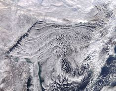Cloud Streets in the Sea of Okhotsk:    Satellite image of cloud patterns over the sea
