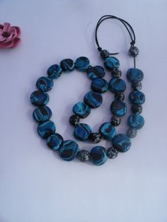 Turquoise blue black beaded necklace by LiloLilsEmporium on Etsy