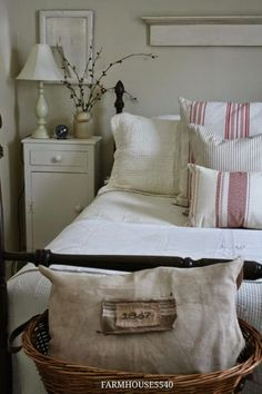 Vintage French Soul  ~   An antique pillow celebrates the age of this old farmhouse.