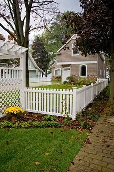 Surround your yard with the classic white picket fence: Covington Vinyl Fencing from Vinyl By Design.