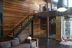 Black meets wood in this mountain villa by Sagemodern