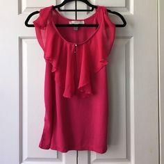 HOT Pink Ruffled Top Flirty hot hot pink sleeveless top from French Laundry. Cute ruffled neck line is continuous around entire neck opening. Rhinestone button details. Perfect for a summer date night with white jeans or with shorts for the weekend! Body 65% polyester, 35% rayon. Woven: 100% polyester. No trades, make an offer! Check out my 25% off two bundle! French Laundry Tops