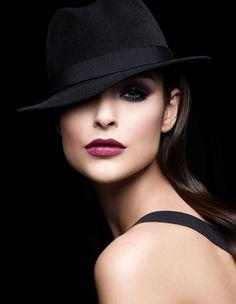 A girl + a hat + attitude = voilà! très chic
