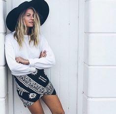 OUTFIT: black wide brimmed hat, white jumper, patterned skirt