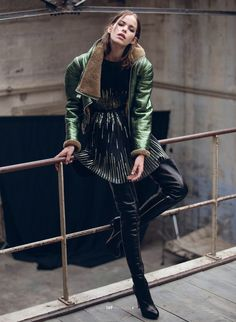 Metallic green leather jacket and black thigh boots runway fashion