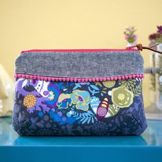 Quality Sewing Tutorials: The Curvy Clutch sewing pattern from Pink Door Fabrics