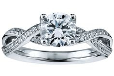Twist-shank solitaire ring with pavé diamonds framed in platinum by Blue Nile