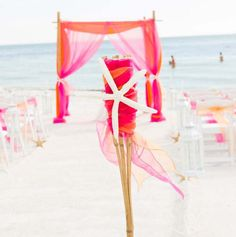 White starfish contrast with bright sashes on the tikis