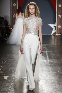 Wedding Suits Want to ditch the skirt but not the train? This Spring 2018 Jenny Packham jumpsuit is the perfect pick thanks to the tulle overskirt. - Do bridal like a boss with the help of one of these alternative looks. Wedding Suits For Bride, Wedding Pants, Wedding Jumpsuit, Chic Wedding, Wedding Ceremony, Wedding Ideas, Bridal Pants, Jenny Packham Wedding Dresses, Bridal Fashion Week