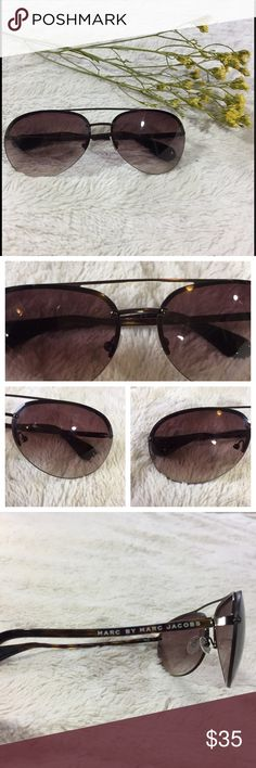 Marc By Marc Jacobs Sunglasses Beautiful Marc By Marc Jacobs Sunglasses. They are dark tortoiseshell with an aviator style. Very Good Condition/ Very Minor Scratching . There is no case or tags included, only the Sunglasses. Marc by Marc Jacobs Accessories Sunglasses