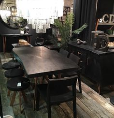 I absolutely love this set from CDI Furniture what you see is dark natural wood and copper metal detailing.