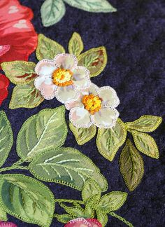 Flower Applique Quilt Detail -  First Place -  Arizona State Fair - Gerlinde Hruzek, in the class for CC/S Seniors, Age 65 and Over, Class 183 Pictoral.  - buttonhole stitch used to fix down the patches of fabric.