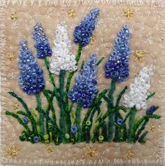 Blue and White Grape Hyacinths by Kirsten's Fabric Art, via Flickr. Loopy french knots, glass beads, couching, embroidery. Kirsten Chursinoff