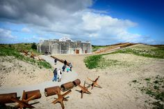 embedded into the landscape, the \'sanctuary in the sand\' transforms a historic bunker into an expansive cultural complex housing sunken galleries, exhibition areas and an events venue.