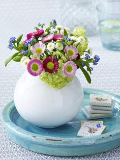 pink, white and pink bellis with snow ball and forget me not...