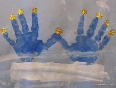 Simple Hanukkah craft - handprint menorah.  I love the gold flame fingertips!