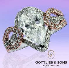 Just #SayYes to this remarkable White and Rose Gold Diamond Engagement ring. This #engagement ring features a stunning pear shaped #diamond surrounded by a two-tone pink and white gold halo that flows into a gorgeous shared prong set diamond twist in the band. Visit your local #GottliebandSons retailer and ask for style number 29565. http://www.gottlieb-sons.com/bridal/engagement-rings/29565