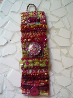 My latest fabric cuff!  ( I am hooked on making these). Am going to approach galleries and high end boutiques shortly to see if they may be interested in my art. Wish me luck!  See my profile if you are interested in this piece.  Copyright 2009. Dorothy Christian. All rights reserved