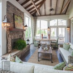Lovely screened porch with volume ceilings and fireplace. #screenedporches #seasonalrooms homechanneltv.com