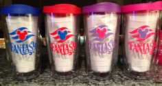 Awesome idea for Disney cups - Looks like these were made for a cruise.  Putting names on them would be cute also.