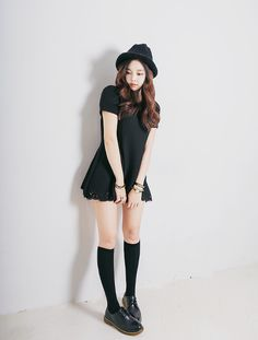 Cute outfit with the black dress, black knee high socks, black shoes, and the black hat and accessories.