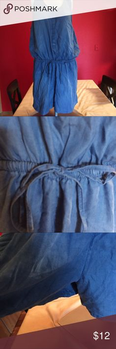 NWT romper Blue denim like material romper. Sleeveless. Side pockets elastic waist with drawstring bow. Snap down front. Cute and comfortable. 23 in pit to pit. 37 1/2 in long. No stretch in material just waist. Merona Dresses
