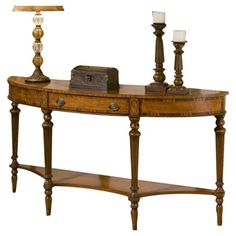 Craft a welcoming vignette and showcase your favorite family photos on this demilune console table, showcasing gorgeous inlays of anegre, rosewood, myrtle bu...
