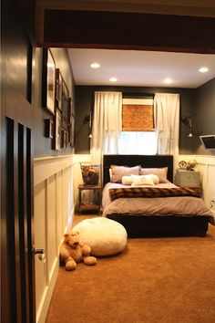 Amazing boy room transformation.  Love the board, gray walls, restoration hardware accessories, barn door.