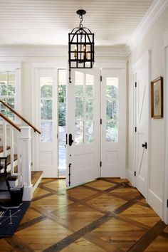 white and wood entry with beautiful flooring