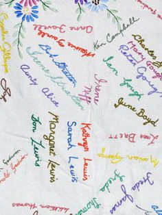 Have guests sign a tablecloth with a non-permanent marker and then have their signatures embroidered.