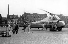 Het heliportterrein vlakbij het Hofplein, ingesloten tussen Katshoek, Vriendenlaan en Rechter Rottekade, 1961.  Van 1953 tot 1965 beschikte Rotterdam over een 'helihaven' in het centrum van de stad. De landingsplaats van deze heliport lag bij het Hofplein. In dat jaar had Rotterdam namelijk nog steeds geen echt vliegveld