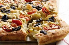 Bake this delicious herb and olive focaccia recipe by Curtis Stone for the family.
