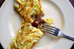 "Bacon and Caramelized Onion Omelet from Three Squares. ""Golden, fried ..."