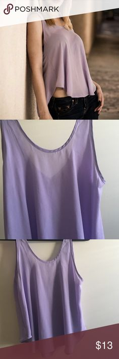 ⚡️LAST CHANCE⚡️Lush Purple Tank Top Worn a few times. I can't tell if it has a tiny stain or it's a wrinkle in the lighting (see photo) but otherwise in good condition. Love the material, so light and comfortable. Great for hot summer days! NO TRADE! Bundle for discount. Lush Tops Tank Tops