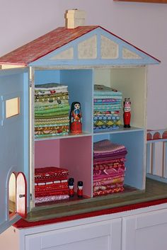 stored in an old dolls house :) oh this is perfection!!!!!!!!