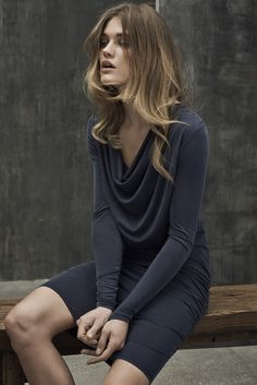 Grey dress with focus on the draped front.