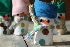 How to make an adorable toilet roll snowman craft with a cardboard tube fabric scraps, buttons and beans. Great fine motor activity for kids.