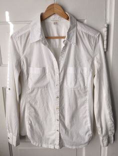 "Eileen Fisher 100% organic cotton button down shirt in white. Woven with knit panels under the arm and back. Long sleeves with tabs to roll up. Size XS. Sleeve: 22"". 