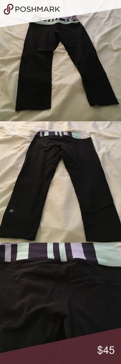Lululemon black wonder under crops Lululemon black wonder under crops with light blue and navy accent waist band. Size 6. Some piling but nothing a clothing shaver could not fix. Still has a lot of life left in these leggings. lululemon athletica Pants Leggings