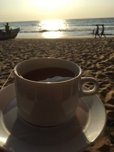 A cup of tea on a beautiful beach. What more do you need?